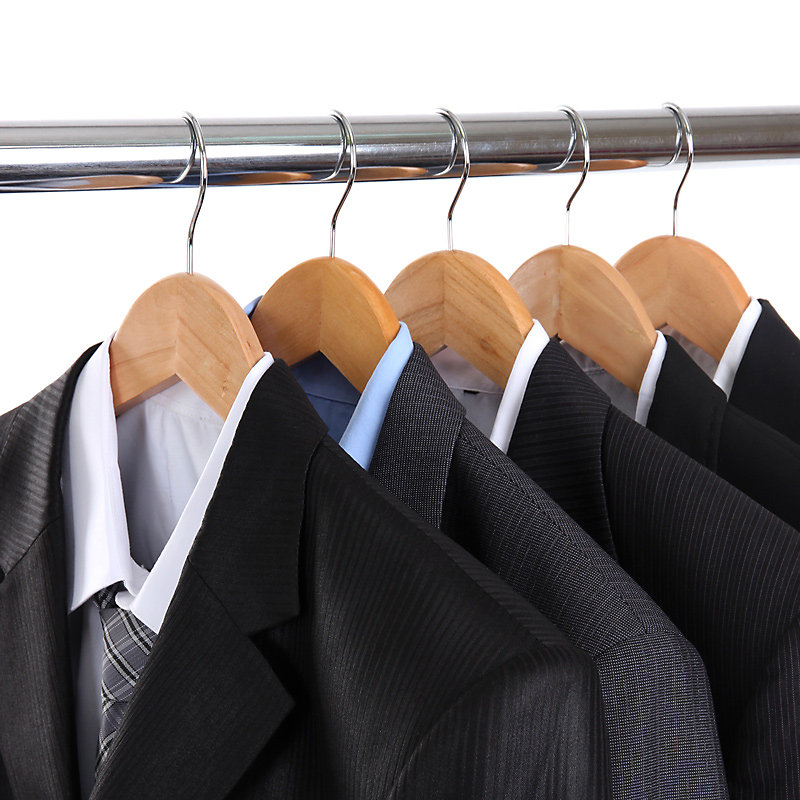 Suits hanging from closet rod