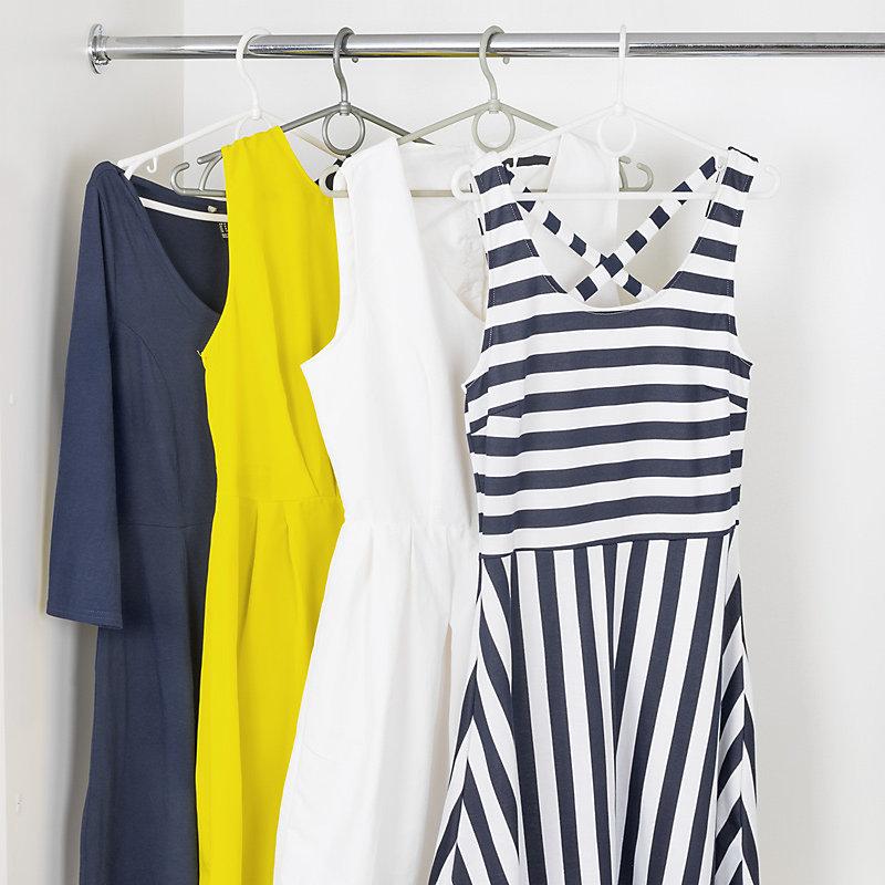 Dresses hanging from closet rod