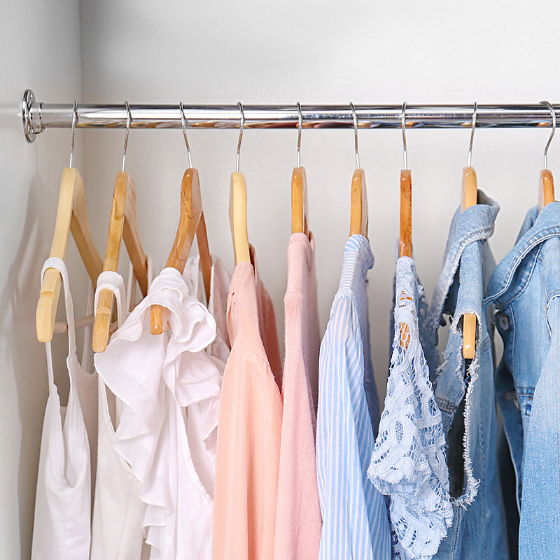 Blouses hanging from closet rod