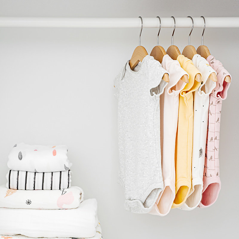 Infant and Toddler Clothing hanging from closet rod